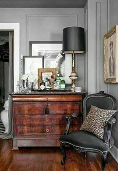Love the black upholstery on this chair! Beautiful vignette on dresser.via brambleberry cottage