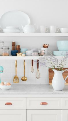 I really like this open shelf concept for the kitchen! You can show off all of your pretty dishes and not have everything so closed in by cabinets and things in the way. #homedecor #rustic #farmhouse #kitchens #kitchenideas #shelves #affiliate