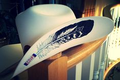 Feather painted cowboy hat