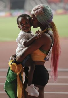 DOHA, Qatar (AP) — Only moments after Shelly-Ann Fraser-Pryce zoomed past the finish line Sunday night, she scooped up something more precious than gold. Her son Zyon came down to. American Athletes, Female Athletes, Shelly Ann Fraser, Christian Taylor, Jackie Joyner Kersee, Dina Asher Smith, Bob Marley Legend, Landscape Photography