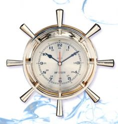 """12 Inch Nautical Ships Wheel clock. Solid brass ship's wheel clock with total measurement of 11-1/2"""" across.  This is a very beautiful nautical clock; clock diameter measuring 6-1/4 inches and the actual face is 5-3/4 inches. Nicest one of this style. Quartz clock includes battery. Mount to any wall fastener to mounting cutout in back side shown."""