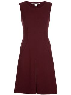 Raisin colour 'Carpreena' sleeveless shift dress from Diane Von Furstenberg featuring a scoop neck, fitted bodice, with nipped in waist, two side pockets and a pleat at the front. The length of the dress is just below the knee and has a copper-tone side zip fastening.