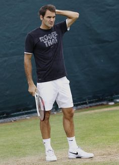 Roger Federer of Switzerland reacts during a training session at the Wimbledon tennis championships in London, Sunday, June 23, 2013. The Championships start Monday, with defending men's champion Roger Federer of Switzerland attempting to win the title for the eighth time. (AP Photo/Kirsty Wigglesworth)