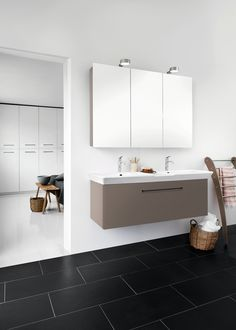 Create coherence between bathroom and  bedroom. Calidris cabinets in the bedroom and  a washstand in a soft stone shade with double  washbasin and mirror cabinet create an exclusive sense of continuity.