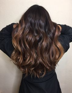 Rich chocolate brown, light soft caramel balayage, soft waves