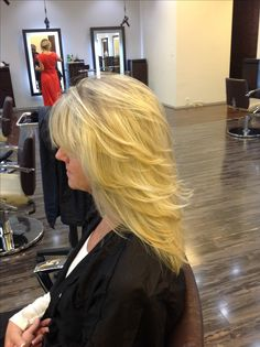 Side view, medium length layers on long hair with pattern matching blonde highlights. @Dres Hair Salon Scottsdale, AZ