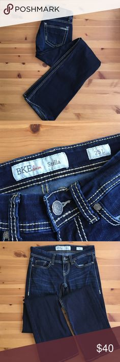 BKE Stella Jeans Next to new BKE jeans in a dark wash with tan stitching. 25 inch waist, 33.5 inch inseam. No signs of wear. Very elastic feeling denim. These are a 25 LONG. No trades, make an offer! BKE Jeans Boot Cut