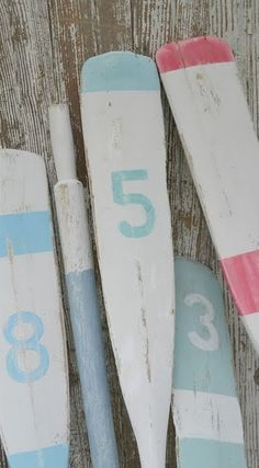 love the numbered oars ~ we have one we found on the beach hanging in our living room