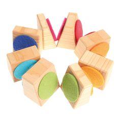 [Grimm's Spiel & Holz Design グリムス社]ブロックタワー 8P ドイツ・グリムス社のナチュラルな木製スタッキングトイです。カラフルなフェルトが付いた木製パーツを積み重ねて遊びます。