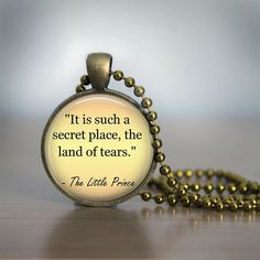 """It is such a secret place, the land of tears."" -The Little Prince  https://www.etsy.com/listing/212500621/the-little-prince-quote-pendant-necklace"