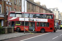 This was the shocking scene in Queenstown Road, Battersea, yesterday when a double decker bus ploughed into a house.