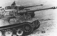 Two Tigers from schwere Panzer-Abteilung 505 showing the numerous hits it had received from both anti-tank rifles and anti-tank guns during the fighting at Kursk and after.