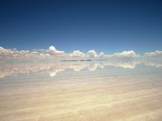 Salar de Uyuni in Potosi, Bolivia.  The largest salt flat in the world is in Bolivia. When it rains, it becomes an immense mirror for the sky. I need to go there.