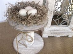 bring an emptied nest indoors, decorate with little silk flower sprigs, and place on to of an old wooden spool or that old cake plate you never use.