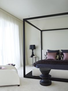 modern poster bed, sheers  Greg Natale | Sydney based architects and interior designers