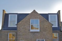 Projected dormer with matching Victorian sash windows
