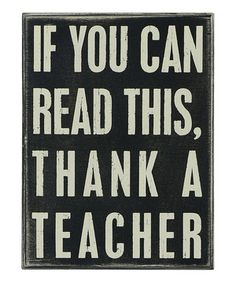 Words to the wise. This wood sign speaks volumes and can be hung on the wall or set freestanding on a shelf or mantel for eloquence anywhere.