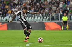 Daniel Alves of Juventus FC scores a goal during the Serie A match between Juventus FC and Cagliari Calcio at Juventus Stadium on September 21, 2016 in Turin, Italy.