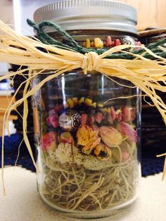 """Handmade necklace and bracelet """"wrapped"""" in a mason jar with moss and dried mini roses."""