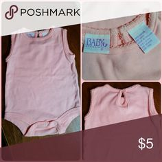 Pink Onesie Shirt Light pink baby girl onesie sleeveless shirt. Button key hole back, snap crotch. Like new condition. Baby Designers One Pieces Bodysuits