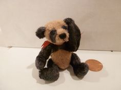 """Mary Bures, A Grand Scale, IGMA fellow - 2 1/2"""" tall stuffed panda, sold on ebay for $55"""