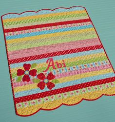 Darling -- plus quick and easy!  Strip quilt with applique and scalloped edges  Cutie Pie Quilt