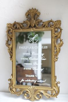Monogram topped wedding timeline sign on ornate gold vintage mirror. Custom personalized signs for events.