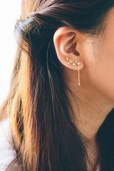 Vine ear pin earrings with a dangling stone drop.