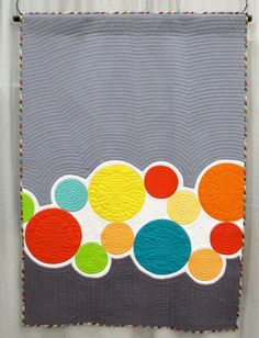 Squiders and Winks, made by Janet McWorkman, machine quilted by Laurie Vandergriff, inspiration: children's game, Tiddly Winks (QuiltCon 2013, category: Applique, Large)