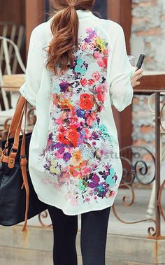 Floral blouse. Would love this.  Plain at front and pattern at back