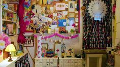 Amy Sedaris' apartment is a warren of whimsy and individuality reflective of the owner. Here is a look through the wonderland. Print Wallpaper, Dark Wallpaper, Cream Chest Of Drawers, Greenwich Apartment, Yellow Cupboards, Leather Poof, White Rocking Chairs, Amy Sedaris, Day And Nite