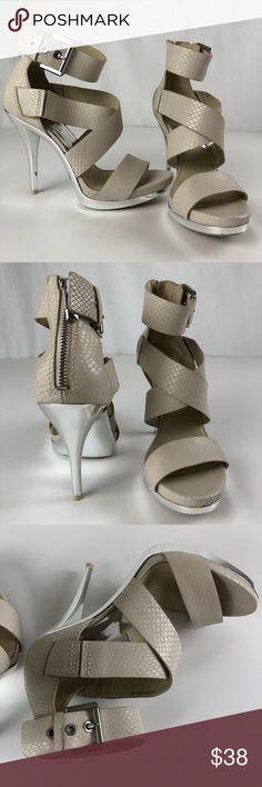 Michael Kors Cream Zipper back heels 7.5M Pre-owned good condition. Size 7.5M please check photos carefully. Smoke free/pet friendly home. No box.  Make sure to check out my other listings!  Thanks for looking!! MICHAEL Michael Kors Shoes Heels