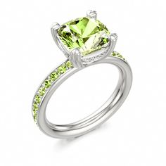 This is my fav!!! Peridot Engagement Ring by Stephen Clarke at Colors of Eden #peridot #engagement #ring