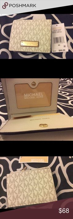 Michael Kors Jet Set Travel Wallet This gorgeous MK logo wallet in Vanilla is compact. As this wallet is perfect for moderate storage of cash and credit cards, you'll never have to sacrifice style for utility. MICHAEL Michael Kors Bags Wallets