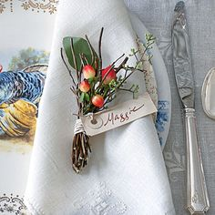 The Place Cards | Tried & True Thanksgiving Bundle several thin twigs, such as curly willow, hypericum berries, and a sprig of seeded eucalyptus. Wrap everything with twine, and add a handwritten tag.
