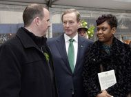 Irish Prime Minister Enda Kenny, right, meets with Damien and Glenda Moore, of Brooklyn, N.Y., at the 17th annual Ireland Chamber of Commerce St. Patrick's Day Breakfast, in New York, Saturday, March 16, 2013. The couple lost their two young sons who were swept from their mother's arms by the violent sea at the height of Superstorm Sandy. (AP Photo/Richard Drew)