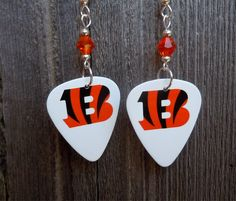White Bengals Tiger Stripe B Guitar Pick Earrings with Orange Crystals by ItsYourPick on Etsy