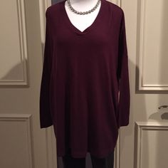 """Deep purple tunic sweater Deep burgundy, v neck tunic sweater. The sleeves are a dolman and ribbed knit. Length from shoulder to gem is 28"""". Excellent condition, only worn once! Sweet Romeo Sweaters V-Necks"""