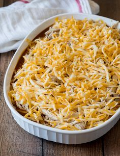 Chicken Tamale Casserole- Once the base is done cooking, cover it with enchilada sauce, shredded chicken and lots of cheese, then bake some more. Tamale Casserole, Casserole Recipes, Mexican Casserole, Enchilada Sauce, Raw Food Recipes, Cooking Recipes, Freezer Recipes, Freezer Cooking, Drink Recipes