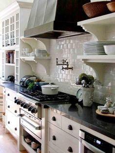 White kitchen, standalone metal/black hood, floating shelves with corbels  carol reed design