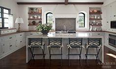 light gray cabinets; walnut perimeter counter & floating shelves; stone waterfall countertop island