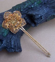 Indonesian Balinese hair comb hair pin hair pick gold tone filigree flower hairpin hair accessory. links to an etsy store that was selling this at time of pinning