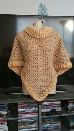 Hot Off My Hook! Project: Cowl Neck Poncho Started: 01 Mar  2016 Completed: 03 Mar 2016 Model: Madge the Mannequin Crochet Hook(s): J, Cowl portion, J, Granny Stitch portion Yarn: Crafters Secret Yarn, RedHeart Super Value Yarn Color(s): Dark Ivory, Buff Pattern Source: Simply Crochet Magazine, Issue No. 25 (Hard Copy) Pattern Designed By: Simone Francis Notes: This is my 78th Cowl-Neck Poncho! I'm gifting this one to a fellow Veteran!