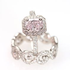 """Brides.com: Engagement Rings with Colored Stones. Style RP167DPK, """"Kelly"""" platinum and diamond ring with a 1.24ct pink diamond center, $50,000, Erica Courtney  See more Erica Courtney engagement rings."""
