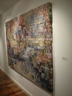 Amanda Nelsen - 40,000 pieces of junk mail, folded and string bundled into 2 inch cubes to create colored pixels. AMAZING!