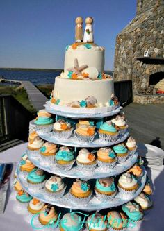 Teal and Orange Beach Wedding - love the cupcakes, but not the top cake and that it's our colors