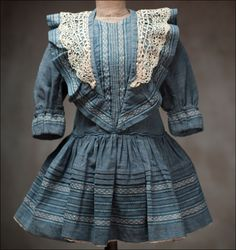 I really like the style of this child's dress...not sure what era it's from....1880ish?