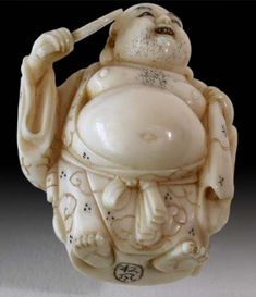 An irrepressible Happy Buddha, with a bulging sack on his back, his ponderous belly overhanging the tied sash, abundance enrobed in cloud patterned and star studded robe, carrying a mirror.