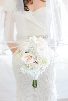 A lush bouquet always makes us smile. Photography by rebeccawood.ca, Floral Design by adutchmillflowershop.com