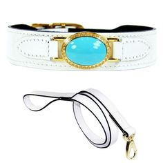 An elegant white patent leather dog collar featuring a large faux turquoise gemstone with Swarovski Crystals.